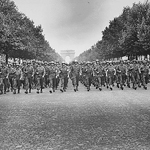 """American troops of the 28th Infantry Division march down the Champs Elysees, Paris, in the 'Victory' Parade, 08/29/1944"" by The U.S. National Archives on Flickr (The Flickr Commons)"