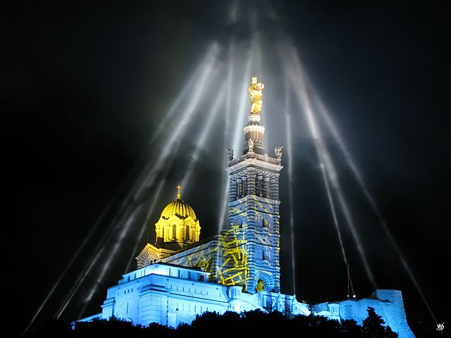 """Marseille Capitale Européenne de la Culture 2013, illuminations Notre-Dame de la Garde 2"" by Denis Honnorat via Wikimedia Commons (CC BY-SA 3.0)"