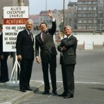 """C8632-25A, President Reagan stands with Chancellor Helmut Schmidt and Berlin Mayor Richard von Weizsaecker at ""Checkpoint Charlie"" at the Berlin Wall. 6/11/82"" courtesy Ronald Reagan Library via Wikimedia Commons (CC BY-SA 3.0)"