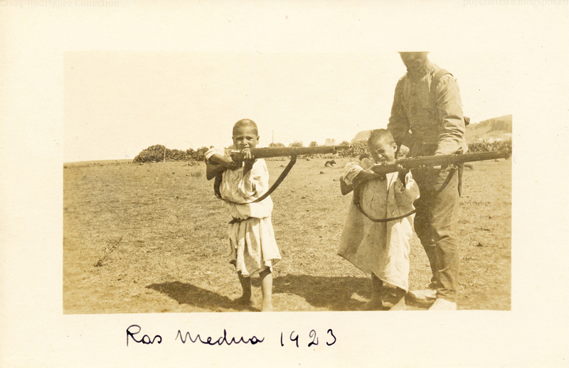 """War In the Rif: Children with Rifles (1923)"" by The Casas-Rodríguez Postcard Collection on Flickr (CC BY-NC-ND 2.0)"