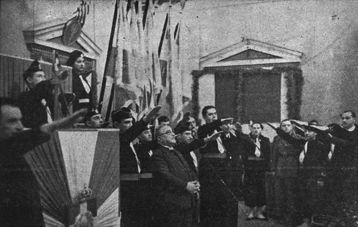 """Young members of the Greek National Youth Organization EON hail in presence of Ioannis Metaxas"" by Jgmarcey via Wikimedia Commons (Public domain)"
