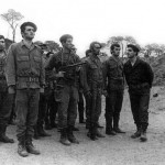 """Bachir Gemayel and William Hawi inspecting the Kataeb troops"""" by Jinanez(CC BY-SA 3.0)."""
