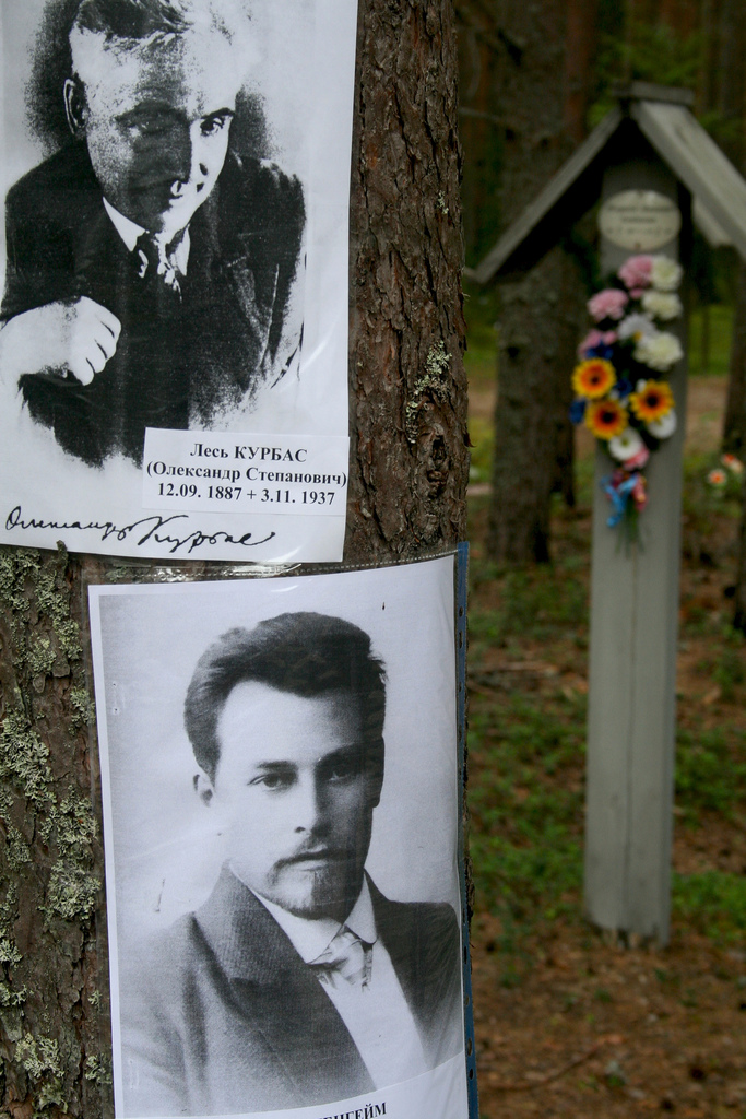 """""""Posters in Sandormokh cemetary"""" by Christian Toennesen on Flickr (CC BY-NC-SA 2.0)"""