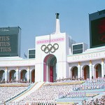 """Olympic Torch Tower of the Los Angeles Coliseum on the day of the opening ceremonies of the 1984 Summer Olympics"" by U.S. Air Force via Wikimedia Commons (Public domain)"
