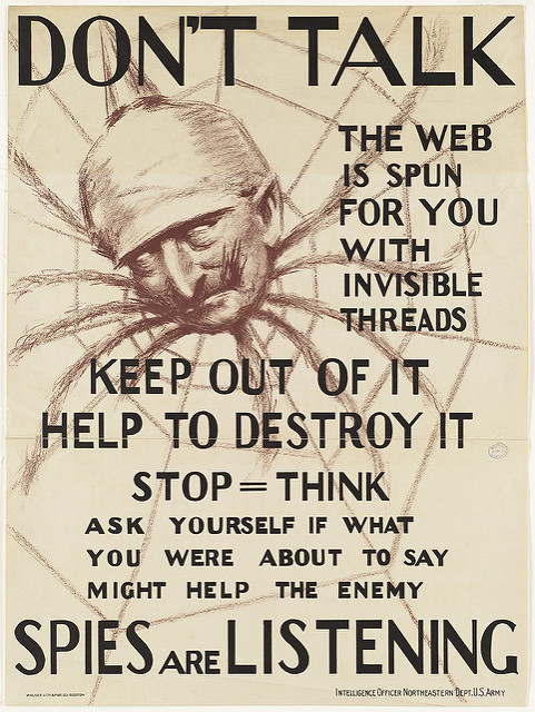 """Don't talk. The web is spun for you with invisible threads, keep out of it, help to destroy it – spies are listening"" by Boston Public Library on Flickr (CC BY 2.0)"