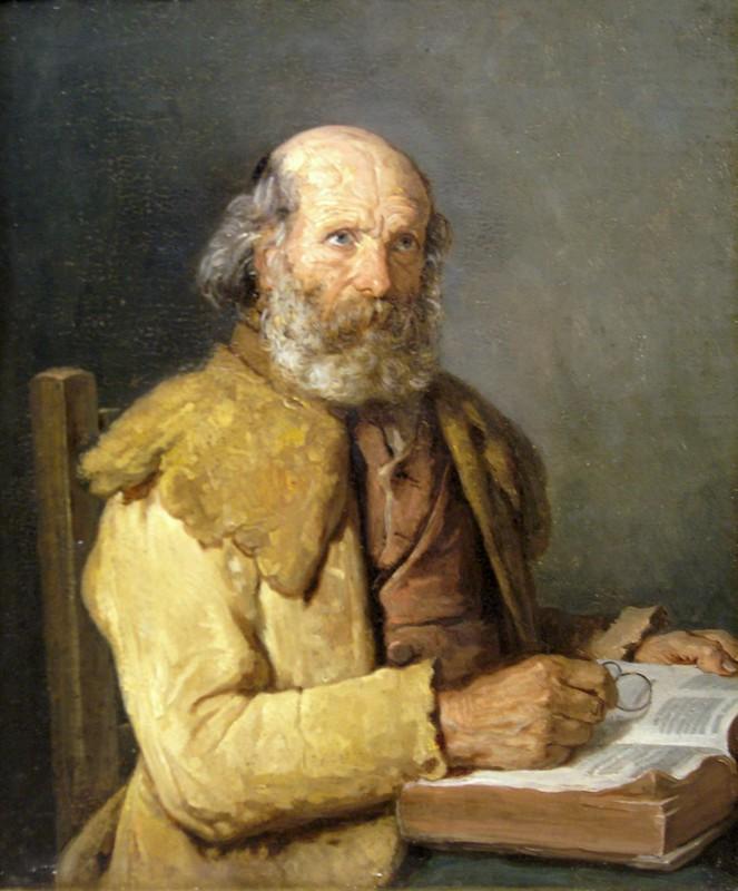 Vieux breton faisant une lecture