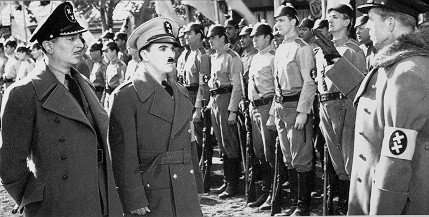 """""""Charlie Chaplin from the end of film The Great Dictator"""" by Trailer screenshot - The Great Dictator trailer on Wikimedia Commons [Public Domain]"""